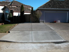 Expand existing driveway and install wood trash enclosure and bike stand